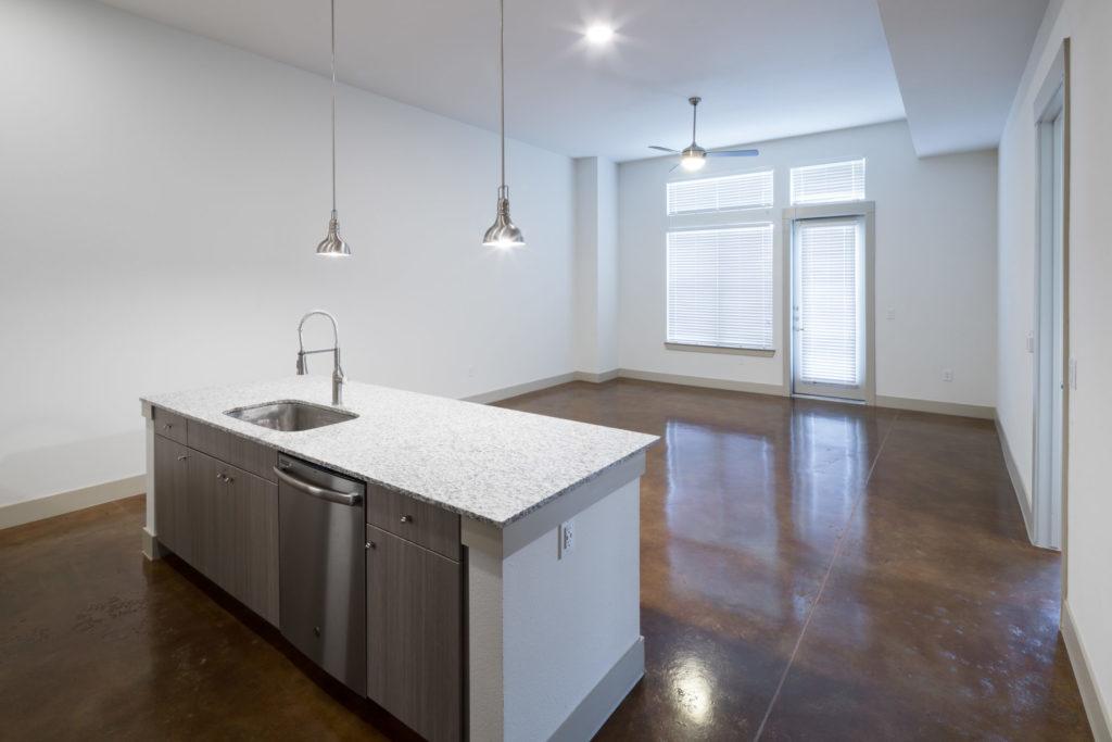 Alexan Summit apartment interior living room and kitchen