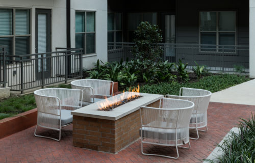courtyard with grilling and fire features at Alexan Summit - Revive Your Relaxing Weekends